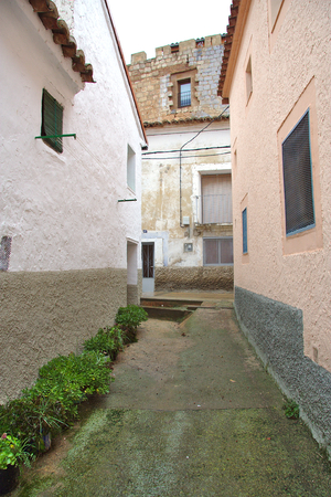 Narrow street in a small town with a castle at the end photo