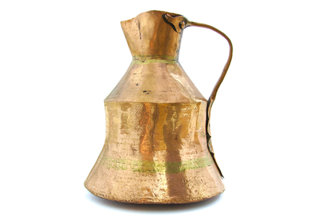 Ancient brass vessel on white background photo