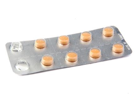 blister: Orange pills in a blister pack on white background