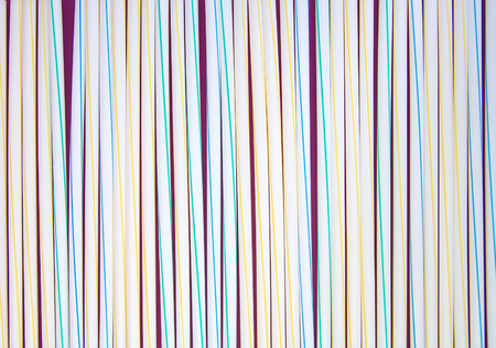 Set of white and colored drinking straws. Background photo