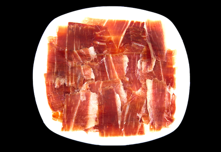 serrano: Plate of spanish serrano ham on black background