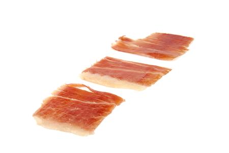 serrano: Three spanish serrano ham slices isolated on white background