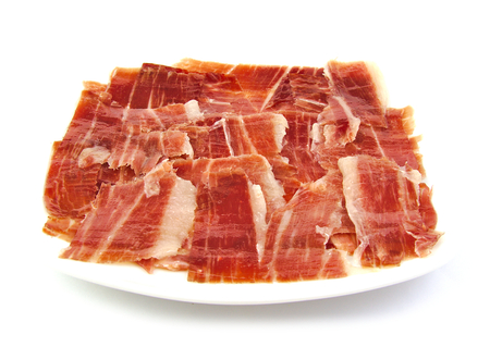 serrano: Serrano ham slices on a white dish. Jabugo. Spanish tapa