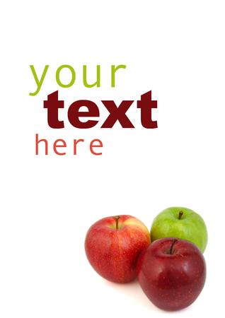 hoja en blanco: Hoja en blanco con manzanas rojas y verdes aisladas en blanco. Su texto aqu� Foto de archivo