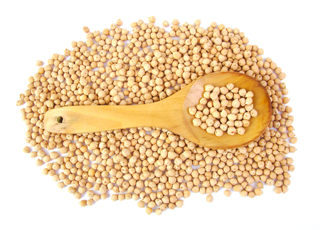 chickpeas: Uncooked chickpeas on wooden spoon on white background