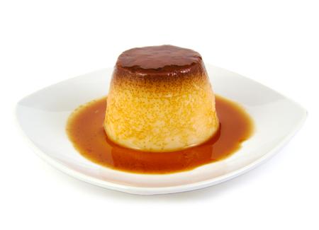 Closeup of creme caramel, caramel custard or custard pudding on white background