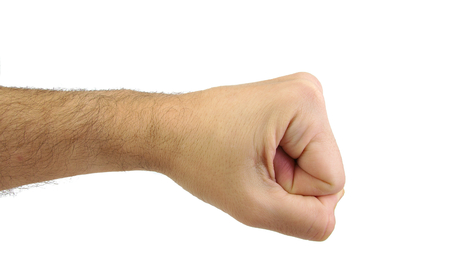 confrontation: Caucasian mans fist isolated on white background. Punch and confrontation concept.