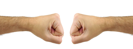 confrontation: Two fists punching each other. Confrontation gesture. Opposite conceptTwo fists punching each other