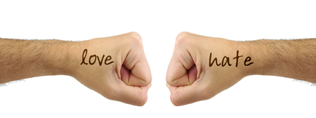 confrontation: Two fists punching each other with LOVE HATE words. Confrontation gesture. Opposite concept