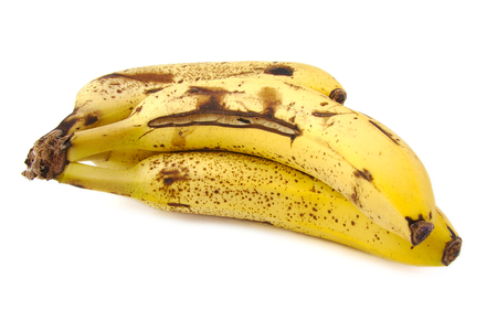 Overripe and rotten bananas on a white background photo
