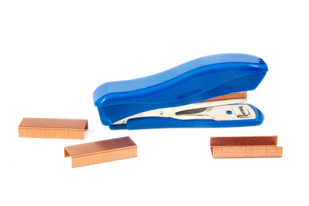 Blue stapler with staples on white background photo