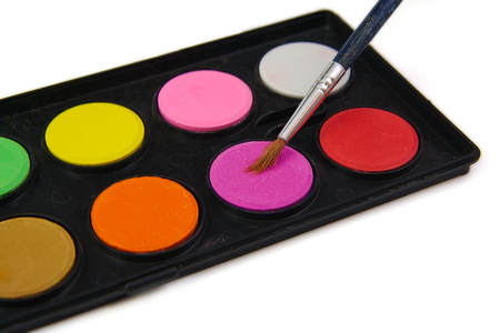 brush in: Watercolor paint and brush in black box on white background Stock Photo