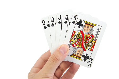 straight flush: A royal straight flush playing cards poker hand in clubs on white background