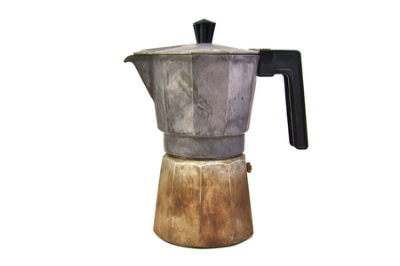 Old, used and rusty italian coffee maker isolated on white background photo