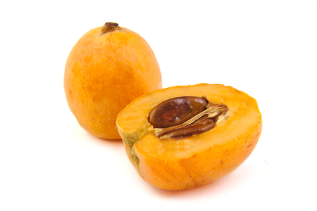 jhy: Close up view of some loquat fruit on white background