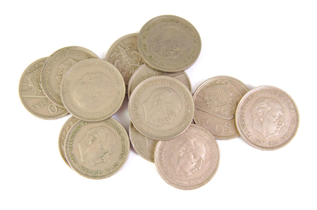dictator: Bunch of old Spanish coins of 50 pesetas showing Franco dictator face on white background. 1957