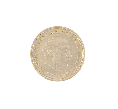 dictator: An old Spanish coin of 50 pesetas showing Franco dictator face isolated on white background. 1957