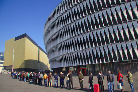 queueing: BILBAO, SPAIN - MAY 28 2015: People queueing for a ticket at San Mames football stadium Editorial
