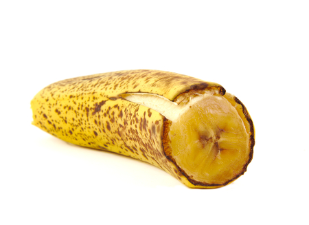 Half a Rotten banana on white background Foto de archivo