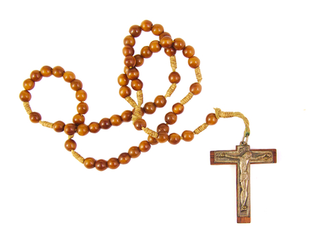 Wooden rosary beads and cross isolated on white background Foto de archivo