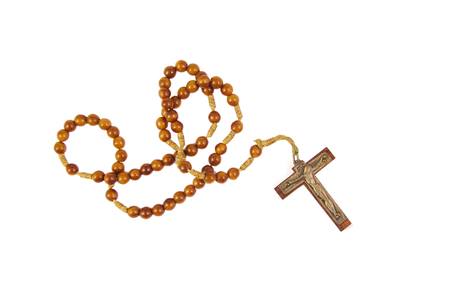 Wooden rosary with a cross isolasted on white background Reklamní fotografie