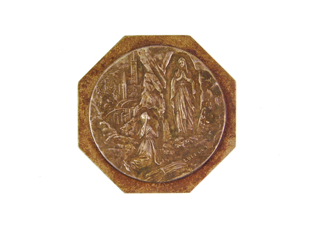 accolade: Bronce medal showing Our Lady of Lourdes isolated on a white background