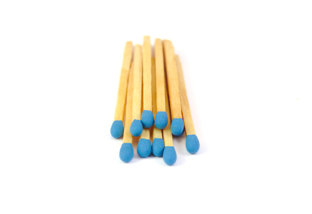 Bunch matches with blue tips isolated on white background Stock Photo