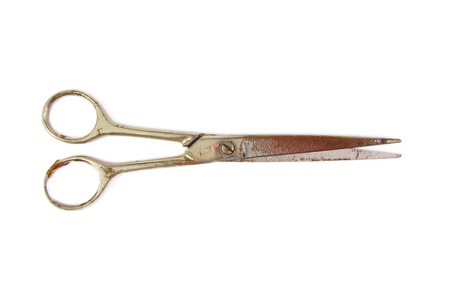 Old and used scissors isolated on a white background