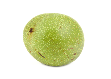 Green walnut isolated on a white background