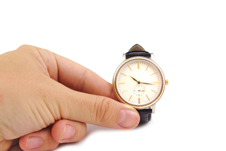 Close up of hand holding watch, isolated on a white background. Time concept