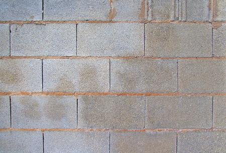 회색 벽돌 벽의 전망입니다. 배경 이미지