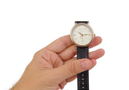 흰색 배경에 고립 된 시계와 남자 손