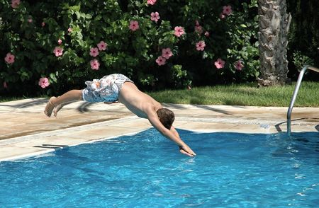 Boy jumping to the pool