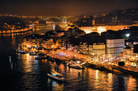 porto: Douro river and the city of Porto at night