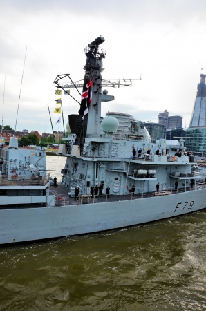 profiled: Modern british warship with the crew profiled on the river Thames Editorial