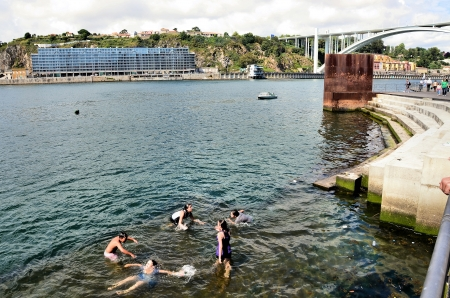 douro: children playing in the Douro river water