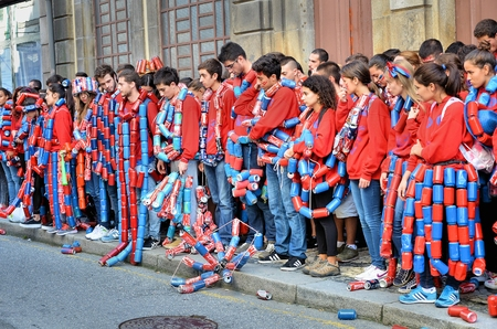 formality: Parade of students of the university of Porto carrying painted cans