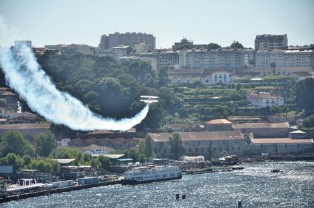 douro: Plane doing stunts over the river Douro