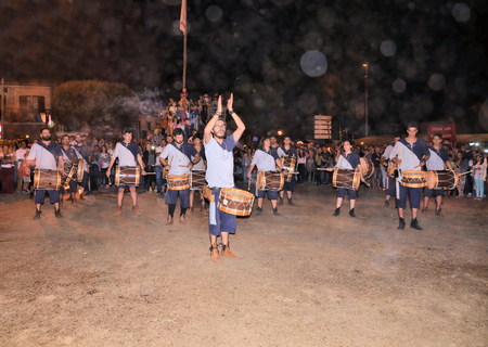 feast: Drummers recreating a medieval feast at night