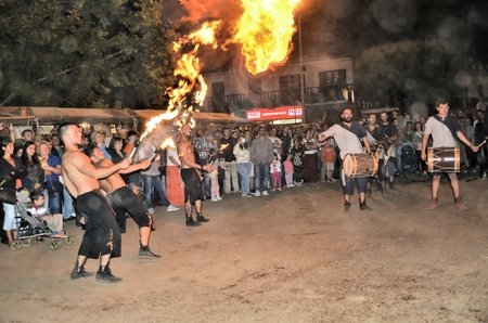 feast: Fire throwers and drummers recreating a medieval feast Editorial