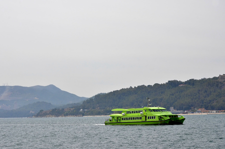 green ridge: Green ferry sailing ridge near the Arrabida in Portugal