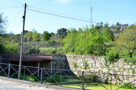 rural areas: Water tank to irrigate the fields very common in rural areas of Portugal Stock Photo