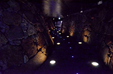Lit passage between the rocks