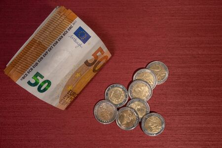 euro money of different values and coins on a table Фото со стока