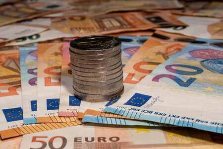 view of two euro coins on euro bills Stock Photo
