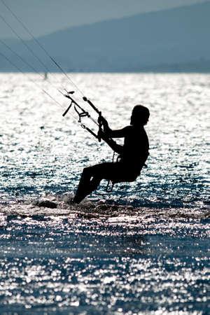 kiteboarding: man doing kite surfing or kiteboarding Stock Photo