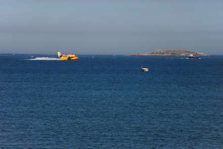 turboprop: Seaplane picking up water from the sea on the Galician coast