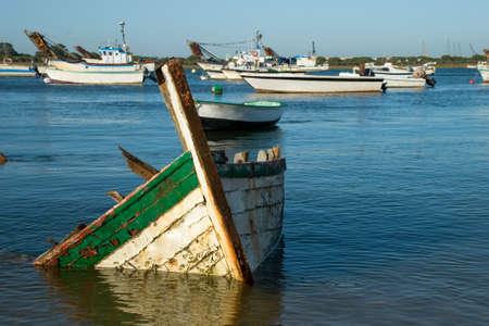 sunken boat: Sunken boat near the shore