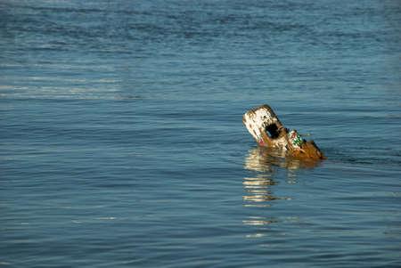 sunken boat: Remains of a sunken boat