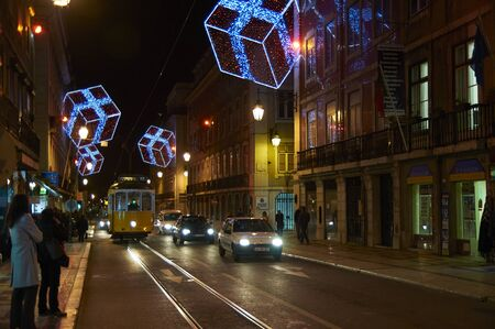 Typical Lisbon scene for Christmas, tram cars, lights, pedestrians ... 스톡 콘텐츠